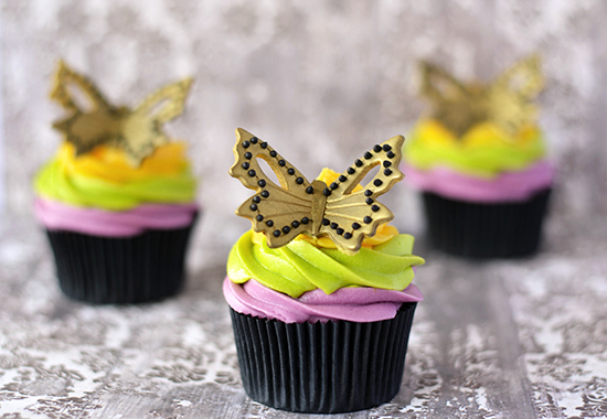 Colorful Carrot Cupcakes With A Butterfly